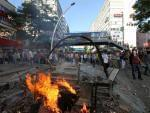 """Turkish youths shout slogan """" Tayyip, resign! """" as they clash with security forces in Ankara, Turkey, Saturday, June 1, 2013."""