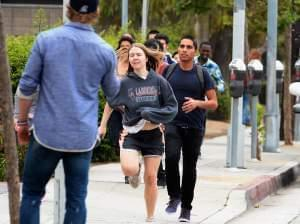 Students rush to safety after shots were fired near the Santa Monica College Friday.