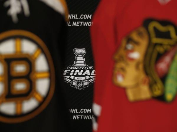 The 2013 NHL Stanley Cup logo is seen between the sweaters of the Boston Bruins and Chicago Blackhawks.