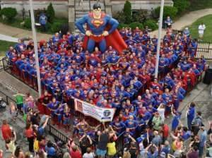 Superman fans stand to try to break the world record for most people dressed as Superman in Metropolis, Illinois.