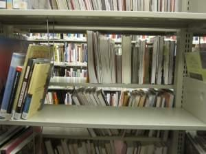 A shelf where books have been removed in the architecture section of the Urbana Free Library.