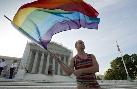 Gay rights advocate Vin Testa waving a rainbow flag in front of the U.S. Supreme Court building