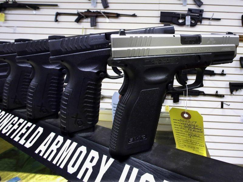 In this Wednesday, Jan. 16, 2013 photo, semi-automatic handguns are seen on display at Capitol City Arms Supply in Springfield, Ill.