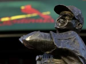 A statue of former St. Louis Cardinals baseball player Stan Musial stands outside Busch Stadium in St. Louis.