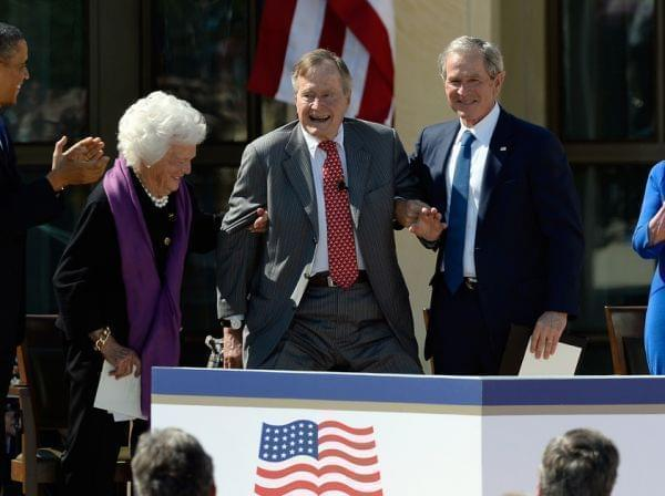 President Obama applauds as former first lady Barbara Bush and former President George W. Bush help President George H.W. Bush stand at the opening ceremony of the George W. Bush Presidential Library on April 25 in Dallas. Former first lady Laura Bus