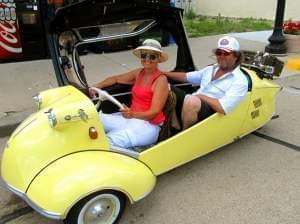 Erik and Mary-Ann Gjermundsen of Norway are making the nearly 3,400-mile trip across the U.S. in their small Messerschmitt.