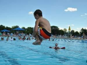 a child doing a cannonball at Sholem Aquatic Center