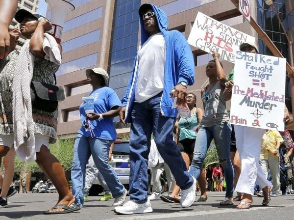 Marchers aligned with the Justice for Trayvon Martin movement