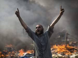 A supporter of ousted Islamist President Mohammed Morsi shouts during clashes with Egyptian security forces in Egypt