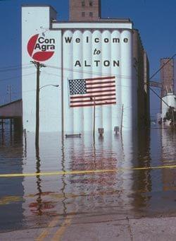 Flood waters surround a grain elevator in Alton, Illinois.