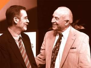 photo of David Inge and Lou Henson talking before an Illinois Pioneers interview