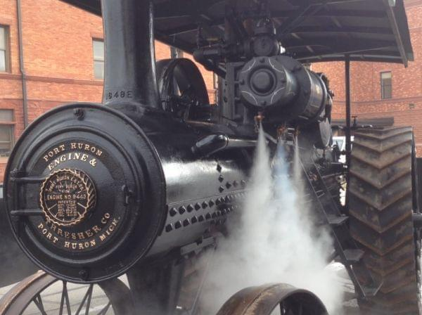 Evan Peach backs the steam engine into place on Friday morning in downtown Urbana.