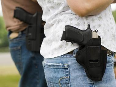 two people with guns