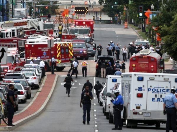 Emergency vehicles and law enforcement personnel respond to a reported shooting at an entrance to the Washington Navy Yard on Monday in Washington, D.C. Several people were shot with the shooter still possibly active.