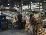 Workers prepare orders to be loaded for shipment at a UPS Healthcare Supply Chain and Distribution Center in Atlanta on March 12. The company recently announced that it would no longer offer coverage for spouses who had their own job-based insurance.