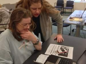 Charlene Aumiller (left) gets help with the health care marketplace from Shannon Killian (right) of the Champaign-Urbana Public Health District on Oct. 1, 2013.