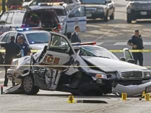 A wrecked Capitol Police car blocks Constitution Avenue NW following a shooting on Capitol Hill in Washington, Thursday, Oct. 3, 2013.
