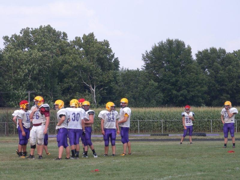 The Monticello High School football team practices in pre-season training in August.