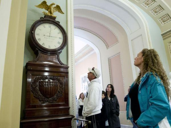 Still Right Twice A Day: Visitors look at the Ohio Clock outside the Senate chamber on Capitol Hill Sunday. The clock that has stood watch over the Senate for 196 years stopped running shortly after noon Wednesday. Employees who wind the clock weekly