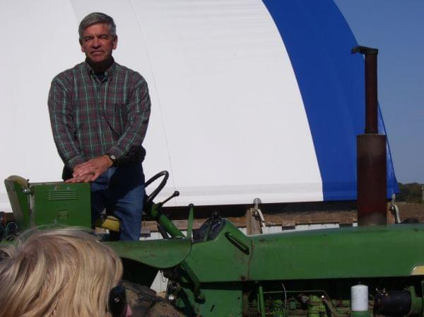 A man standing on a tractor