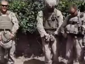 A still frame taken from a YouTube video shows Marines who were later disciplined for desecrating three dead Taliban members in a 2011 incident in the southern Afghan province of Helmand.
