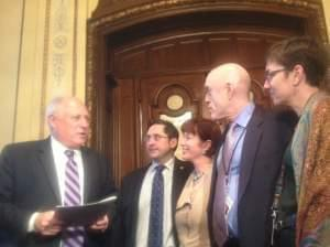 Sponsors of the same-sex marriage bill - Rep. Sam Yingling (D-Grayslake), Sen. Heather Steans (D-Chicago), Rep. Greg Harris (D-Chicago) and Rep. Kelly Cassidy (D-Chicago) - approved by the General Assembly on Tuesday hand-deliver it to Gov. Pat Quinn