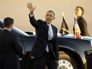 President Obama waves as he departs Love Field Airport after shaking hands with supporters Wednesday in Dallas.