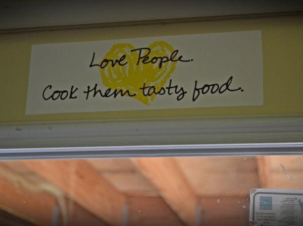 """A sticker that reads """"Love People. Cook them tasty food."""""""