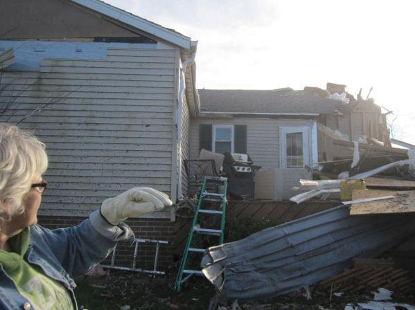 Mary Sutherlin looks at what's left of her home Tuesday, November 19 in Gifford.