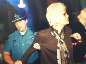Mary Lee Sargent being arrested at a protest at the state capitol after a committee refused to allow a bill amending the human rights act on May 9, 2001.
