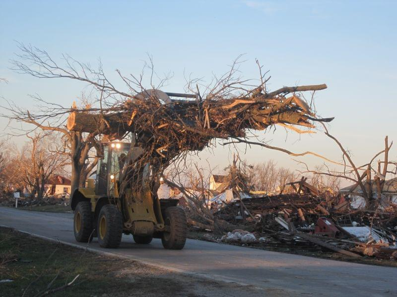 A clean up truck hauls away broken tree branches in Gifford, Ill. on Nov. 18, 2013.