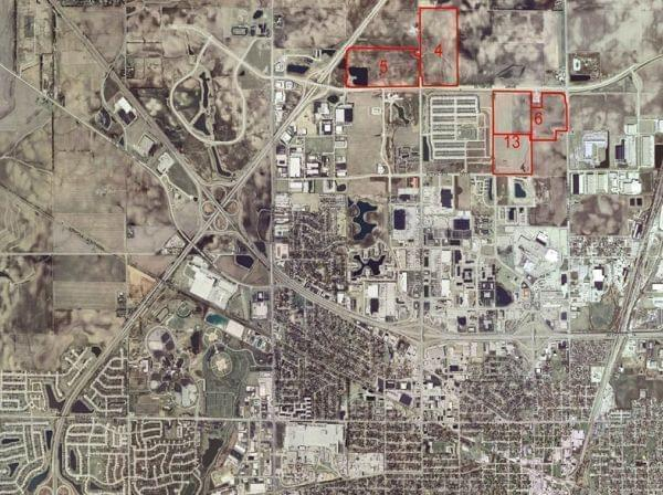 The potential sites for Champaign's new high school are marked in red.