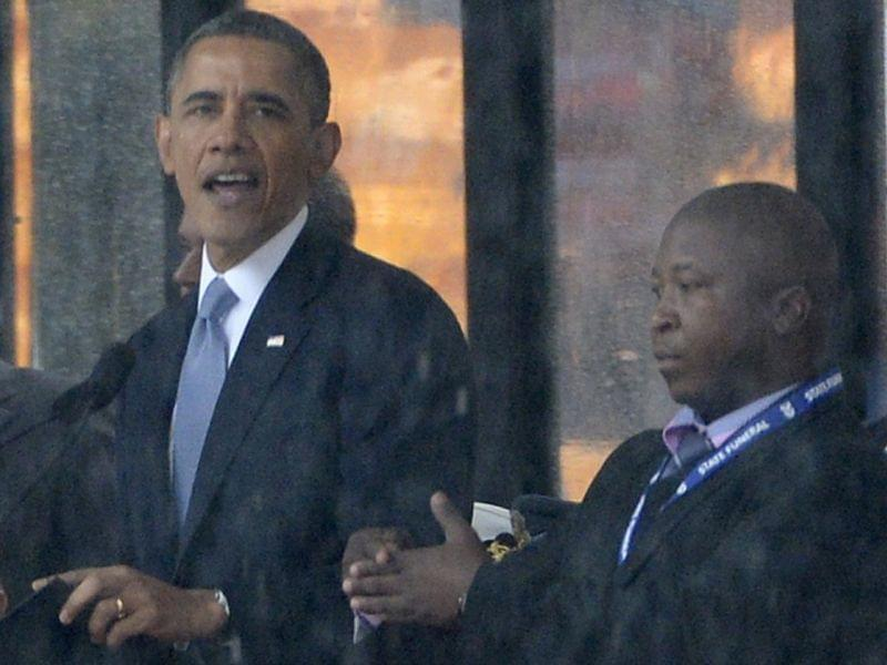 Thamsanqa Jantjie, 34, appeared alongside President Obama and other world leaders during Tuesday's memorial for Nelson Mandela in Johannesburg, South Africa. Many in the deaf community are outraged over Jantjie's sign language interpretatio