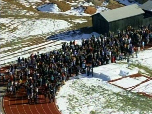 In this frame grab taken from video by KCNC television news in Denver, students of Arapahoe High School in Centennial, Colo., gather at a running track on Friday after a shooting at the school. Two students were injured in the shooting incident befor