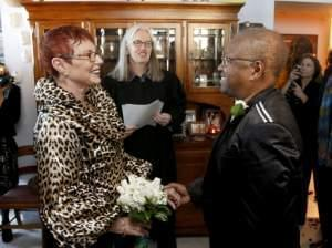 Patricia Ewert, left, and Vernita Gray, right, stand before Cook County Judge Patricia Logue, center, as she presides over their wedding ceremony, the first same-sex marriage in Illinois, at the couple's home Wednesday, Nov. 27, 2013, in Chicago