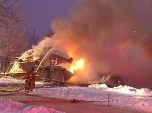 Firefighters work to put out the blaze  on Dec. 17, 2013.