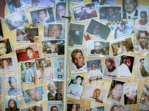 Pictures of Chicago residents who have died by gunfire are posted on the city's South Side.
