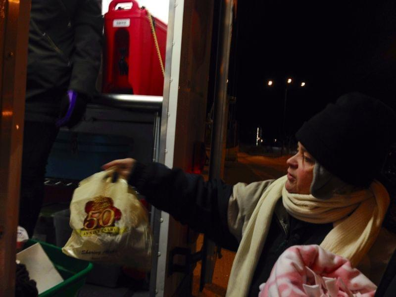 Teresa Webb, 50, has been homeless for the last eight months. She gets supplies from the Salvation Army truck in Champaign on Thursday, Jan. 2, 2014.