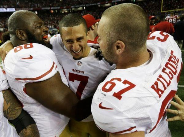 San Francisco 49ers' Colin Kaepernick (7) celebrates with Leonard Davis and Daniel Kilgore (67) after the NFL football NFC Championship game against the Atlanta Falcons Sunday, Jan. 20, 2013, in Atlanta. The 49ers won 28-24 to advance to Superbo