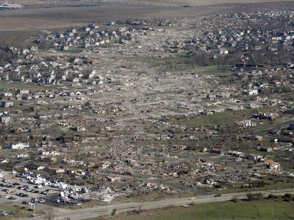 This file aerial photo of Nov. 18, 2013, shows the path of a tornado that hit the western Illinois town of Washington the day before.