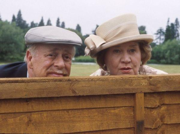 Richard and Hyacinth Bucket peer over a fence.