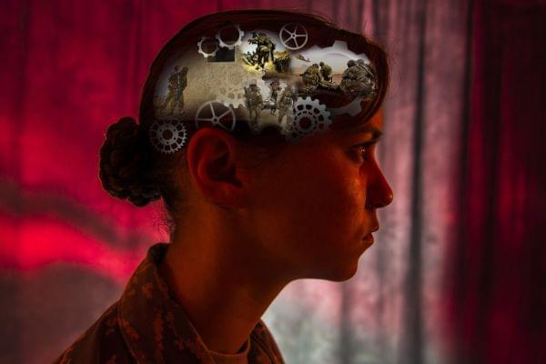 A graphic image of a woman's head showing gears inside