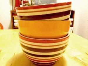 A stack of bowls on a kitchen table.