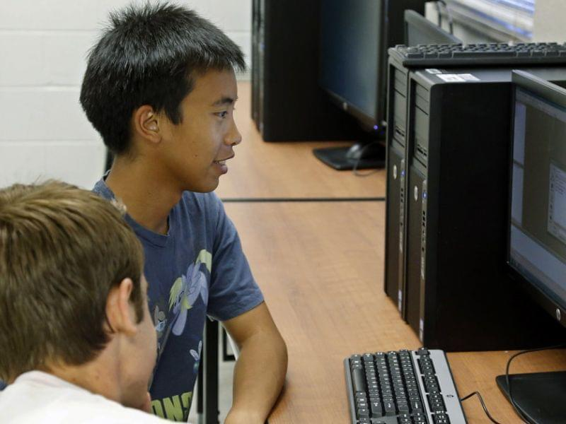 Alex Tu, left, an Advanced Placement student, works during a computer science class in Midwest City, Okla. There's been a sharp decline in the number of computer science classes offered in U.S. secondary schools.