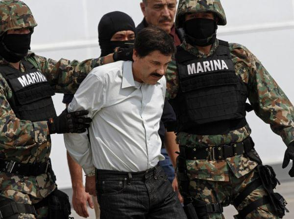 "Mexican Marines escort Joaquin ""El Chapo"" Guzman to a helicopter in Mexico City on Saturday."