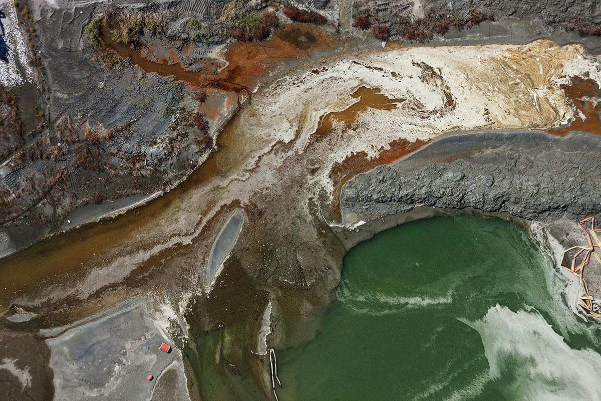 Coal ash spill into a river