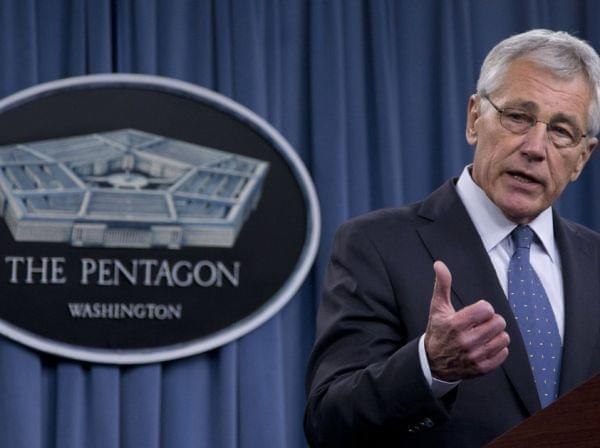 Defense Secretary Chuck Hagel briefs reporters at the Pentagon on Monday. Hagel and President Obama will need to fight through a wall of resistance to their proposed defense budget cuts, say former members of a defense base closing commission.