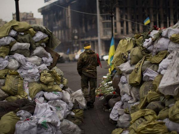 An anti-Yanukovych protester walks past a barricade in Independence Square, the epicenter of the country's current unrest, in Kiev, Ukraine, on Wednesday.
