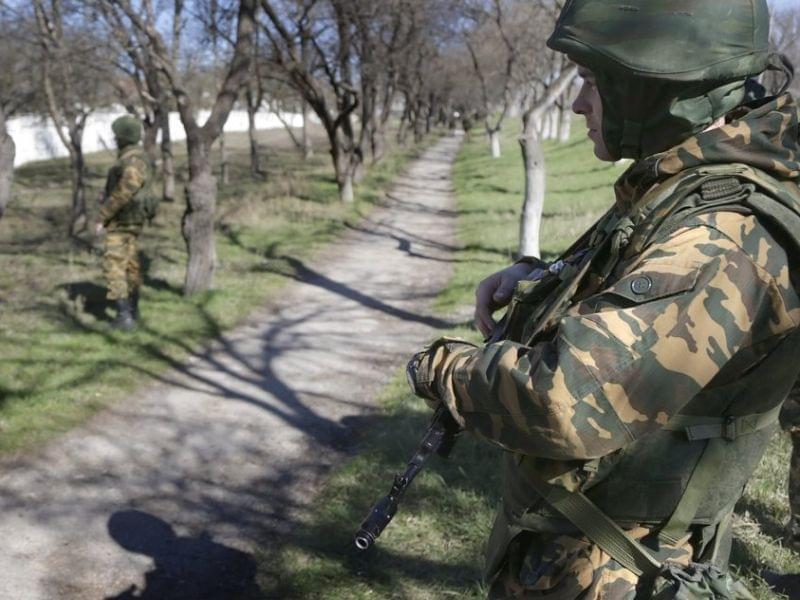 Armed men outside Ukrainan military unit