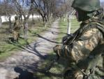 Armed men outside Ukrainan military unit